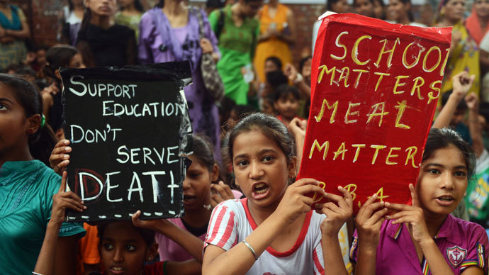 Indian children and activists shout anti-government slogans as they march to parliament demonstrating against the death of 23 children in Bihar state after they ate poisoned 'midday meals' during a protest in New Delhi on July 20, 2013.(AFP Photo / Raveendran)