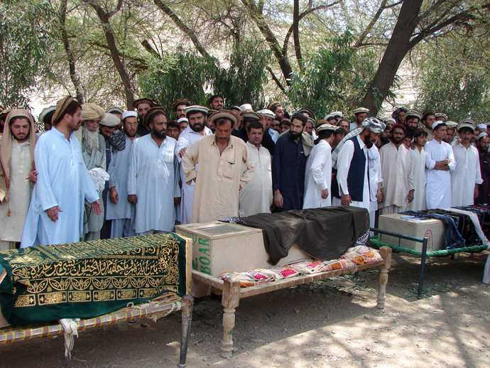 Pakistani tribesmen gather for funeral prayers before the coffins of people allegedly killed in a US drone attack, claiming that innocent civilians were killed during a June 15 strike in the North Waziristan village of Tapi, 10 kilometers away from Miranshah, on June 16, 2011 (AFP Photo)