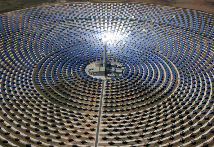 This handout picture released by Gemasolar shows the Torresol Energy Gemasolar thermasolar plant in Fuentes de Andalucia near Sevilla, southern Spain. (AFP Photo/Gemasolar)
