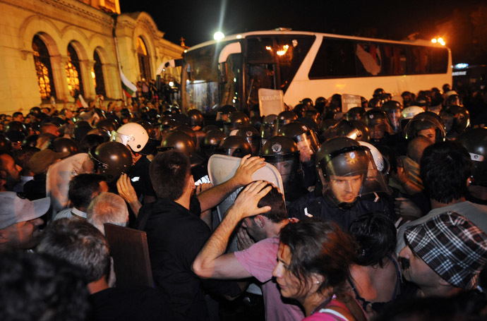 Bulgarian riot policemen push protestors back to make way for lawmakers and parliament staff driven in a bus during an anti-government protest in Sofia on July 23, 2013. (AFP Photo/Dimitar Dilkoff)