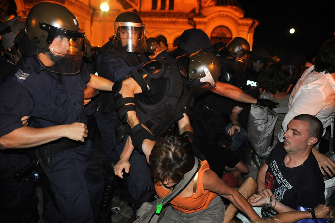 Bulgarian riot policemen push protestors during an anti-government protest in Sofia on July 23, 2013. (AFP Photo/Dimitar Dilkoff)