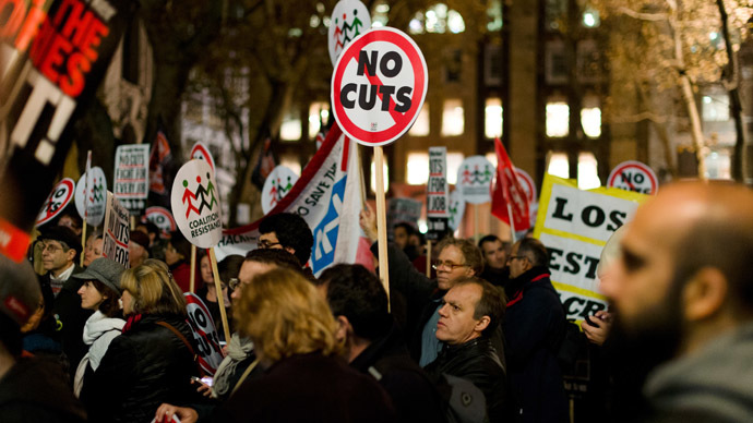 Anti-austerity cut protestors demonstrate outside the offices of the European Commission Representation in the UK in central London (AFP Photo/Leon Neal)
