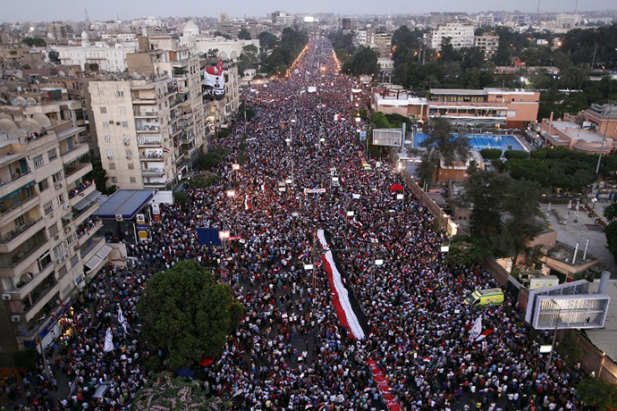 Hundreds of thousands of Egyptian demonstrators gather outside the presidential palace in Cairo during a protest calling for the ouster of President Mohamed Morsi on June 30, 2013. (AFP Photo / Mahmud Khaled)