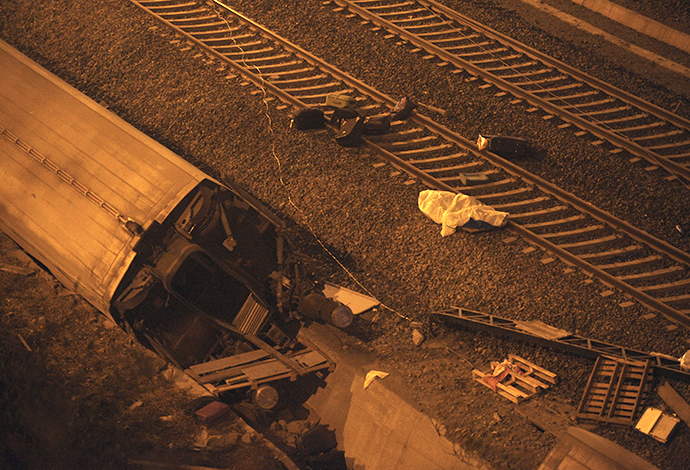 A picture taken on July 24, 2013 shows a derailed car at the site of a train accident near the city of Santiago de Compostela. (AFP Photo / Miguel Riopa)