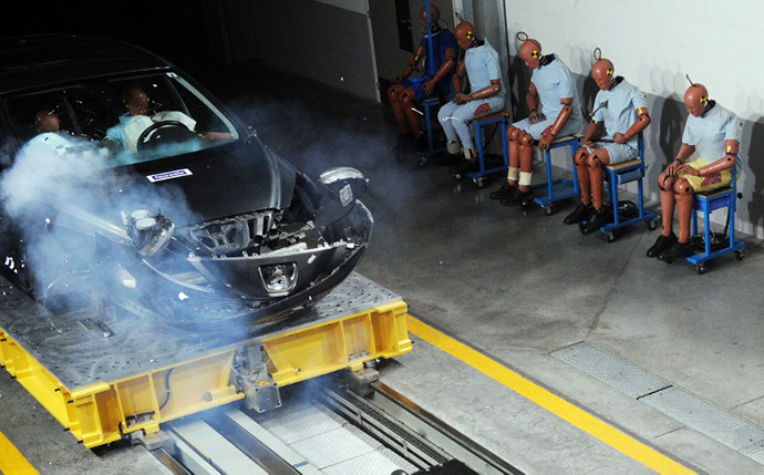 A car loaded with manequins recoils at a crash testing centre (AFP Photo / Jean Francois Monier)