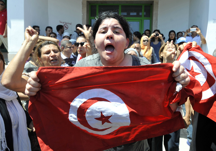 Belkaeis Brahimi, the daughter of Tunisian opposition politician Mohamed Brahmi, shows a national flag shouting outside a hospital after her father was killed on July 25, 2013 in Ariana, outside Tunis (AFP Photo)