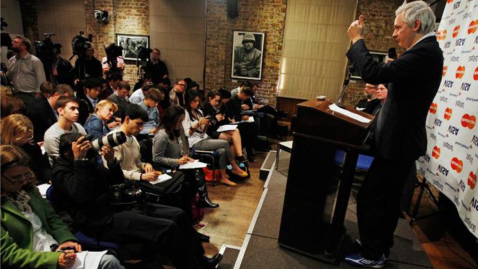 WikiLeaks founder Julian Assange (R) (Reuters / Luke MacGregor)