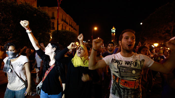 Tunisians gather to protest the killing of opposition politician Mohamed Brahimi in Tunis, July 25, 2013.(Reuters / Anis Mili)