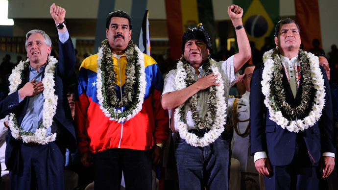(L-R) Bolivia's Vice-President Alvaro Garcia Linera, Venezuela's President Nicolas Maduro, Bolivia's President Evo Morales (L) and Ecuador's President Rafael Correa listen to the Bolivian national anthem during a welcoming gathering in honour of Morales, in Cochabamba, on July 4, 2013.(AFP Photo / Jorge Bernal)