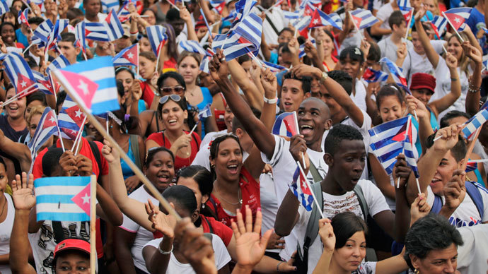 People wave flags during the May Day parade in Havana's Revolution Square May 1, 2013.(Reuters / Desmond Boylan)