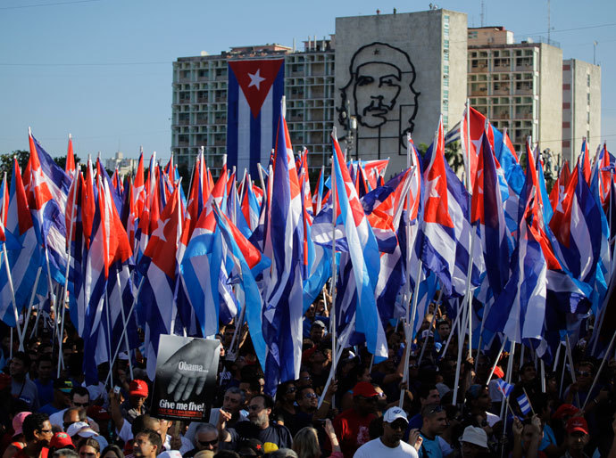 People carry Cuban flags at the May Day parade in Havana's Revolution Square May 1, 2012.(Reuters / Desmond Boylan)