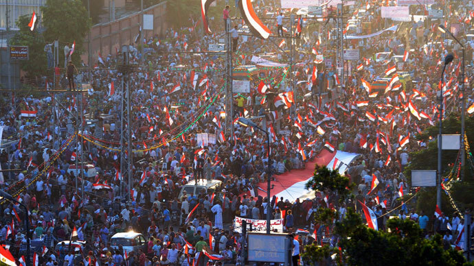Anti-Mursi protesters shout slogans as they wave Egyptian national flags during a rally and march around El-Thadiya presidential palace in Cairo July 26, 2013.(Reuters / Amr Abdallah Dalsh)