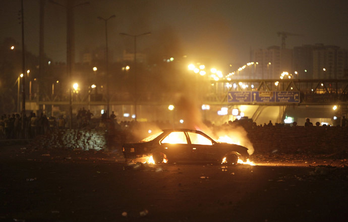 A car that members of the Muslim Brotherhood and supporters of deposed Egyptian President Mohamed Mursi say was burnt by police and plain-clothed people is seen during clashes in Nasr city area, east of Cairo July 27, 2013. (Reuters/Asmaa Waguih)