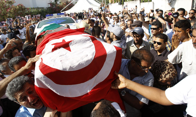Mourners carry the coffin of slain opposition leader Mohamed Brahmi during his funeral procession towards the nearby cemetery of El-Jellaz, where he is to be buried, in Tunis July 27, 2013. (Reuters/Zoubeir Souissi)