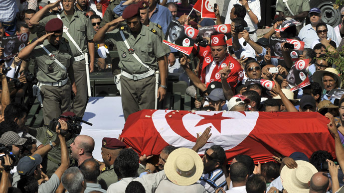 Tear gas, clashes in Tunisia after funeral of slain opposition leader draws thousands