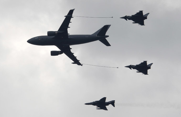 An Airbus A310 MRTT tanker transport aircraft (L) prepares to refuel two Eurofighter jets (R) as they are accompanied by a Tornado fighter jet at the ILA International Air Show in Schoenefeld south of Berlin (Reuters/Fabrizio Bensch )