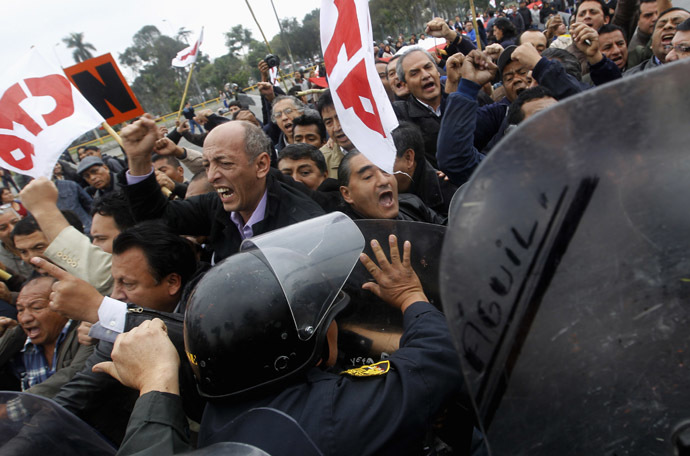 Peruvian special police control protesters during a march against the government in Lima July 27, 2013. (Reuters/Mariana Bazo)
