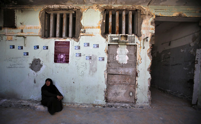 A Palestinian woman sits at Saraya prison that had been used by Israeli security services to keep Palestinian prisoners during Israel's occupation of Gaza Strip (Reuters/Suhaib Salem)