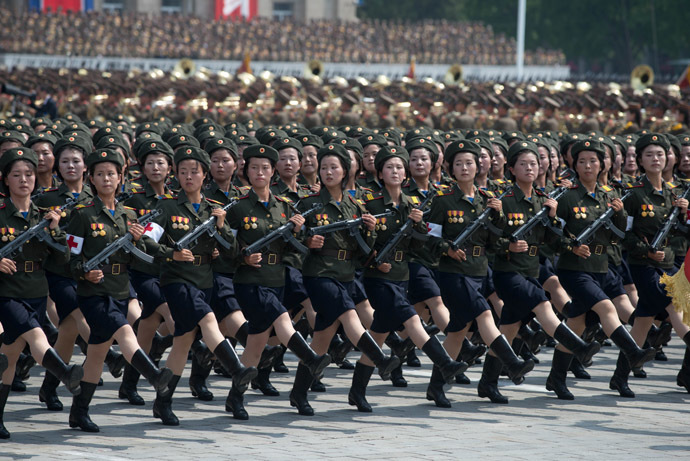 North Korean soldiers march during a military parade past Kim Il-Sung square marking the 60th anniversary of the Korean war armistice in Pyongyang on July 27, 2013. (AFP Photo/Ed Jones)