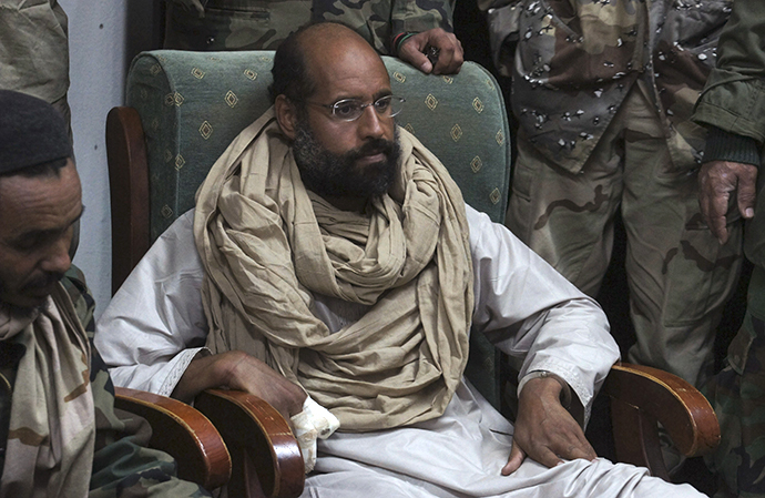 Saif al-Islam is seen after his capture, in the custody of revolutionary fighters in Obari, Libya November 19, 2011. (Reuters)