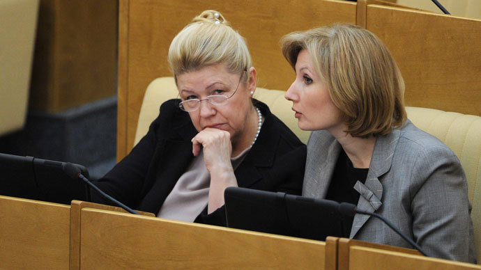 Olga Batalina, First Deputy Chair of the State Duma Committee on Family, Women and Children's Issues, and Yelena Mizulina, Chair of the State Duma Committee on Family, Women and Children's Issues, (right to left) at a State Duma plenary session.(RIA Novosti / Vladimir Fedorenko)