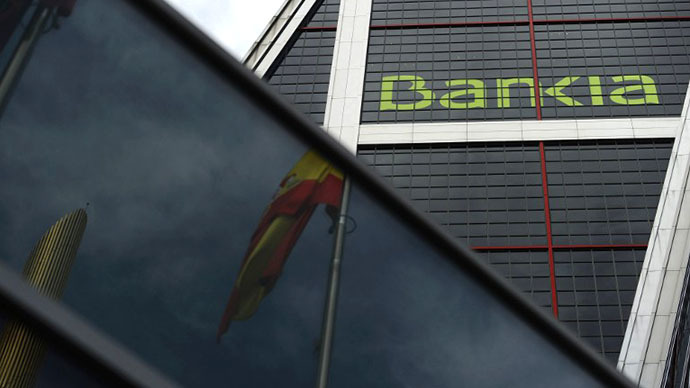 Spanish key lenders boast earnings turnaround, but bad debts still weigh