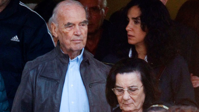 Convicted former Nazi SS captain Erich Priebke (L) leaves after attending a mass at a church in northern Rome October 17, 2010. Priebke, who is serving a life sentence under house arrest, celebrated his 100th birthday on July 29, 2013.(Reuters / Alessandro Bianchi)