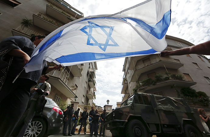 People hold an Israeli flag during a protest against convicted former Nazi SS captain Erich Priebke in front of his residence in Rome July 29, 2013. (Reuters)