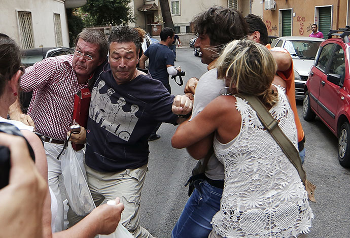 Protesters react against a relative of convicted former Nazi SS captain Erich Priebke during a protest in front of his residence in Rome July 29, 2013. (Reuters)