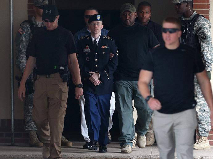 U.S. Army Private First Class Bradley Manning (C) is escorted by military police as he leaves his military trial after he was found guilty of 20 out of 21 charges, July 30, 2013 Fort George G. Meade, Maryland. (Mark Wilson/Getty Images/AFP)