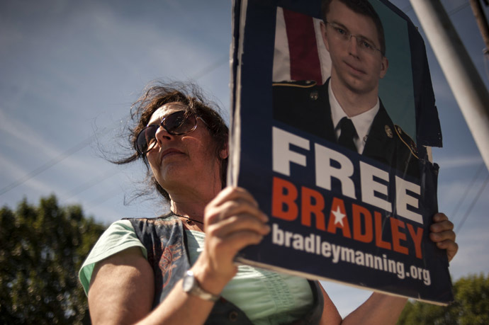 A supporter of U.S. Army Private First Class Bradley Manning protests outside the main gate before the reading of the verdict in Manning's military trial at Fort Meade, Maryland July 30, 2013. (Reuters/James Lawler Duggan)