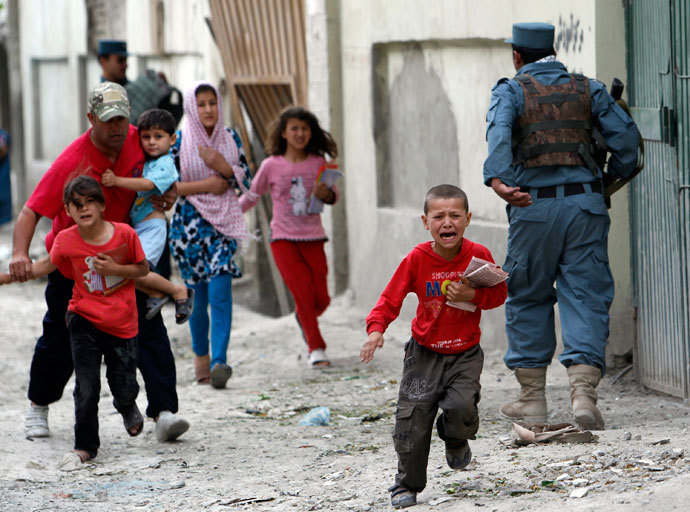 Children run away after an explosion in Kabul.(Reuters / Omar Sobhani)