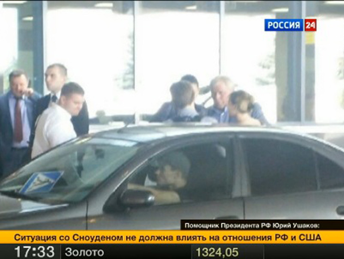 Photo of Edward Snowden leaving Sheremetyevo Airport (Video still from http://www.vesti.ru)
