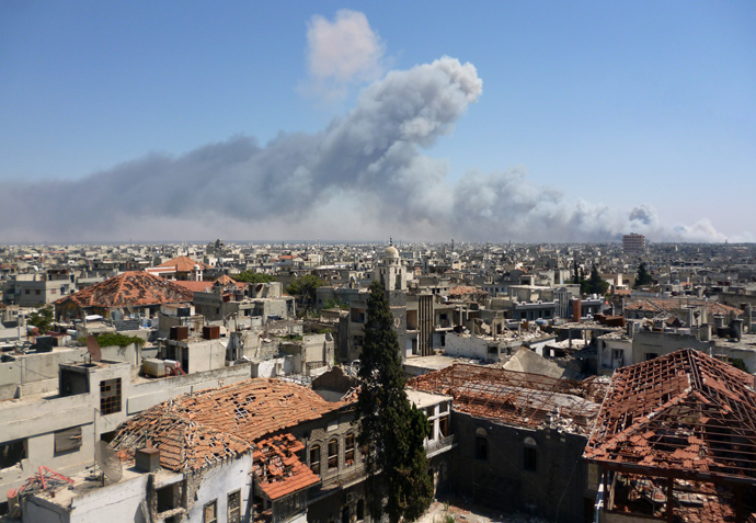 A handout image released by the Syrian opposition's Shaam News Network on August 1, 2013, shows smoke billowing from the site of an ammunitions depot blast in the Wadi al-Zahab district of Homs in central Syria (AFP Photo / HO / Shaam News Network)