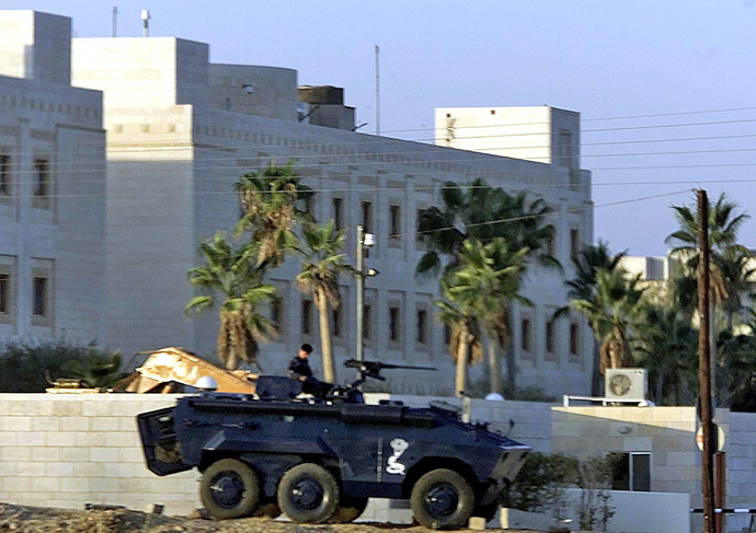 Jordanian policeman sits on the top of an Armoured Personal Carrier (APC) in front of U.S. embassy in Amman (Reuters / Goran Tomasevic)