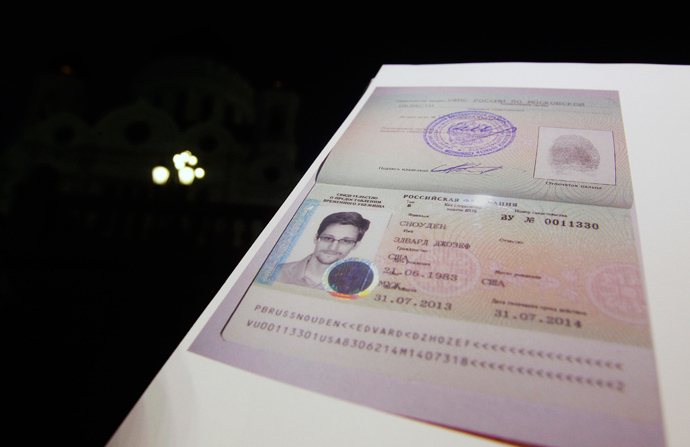 Fugitive former U.S. spy agency contractor Edward Snowden's new refugee documents granted by Russia is seen during a news conference in Moscow August 1, 2013 (Reuters / Maxim Shemetov)