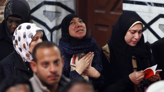 Military fire shots, tear gas at Cairo mosque filled with Islamist protesters