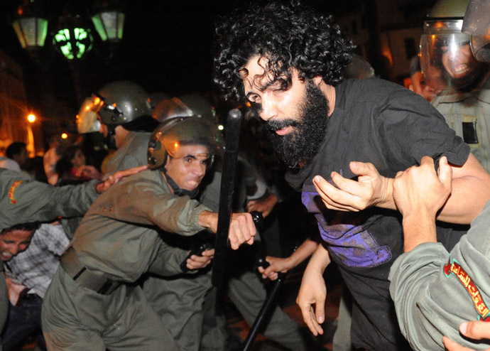 Protesters confront with police during a demonstration on August 2, 2013 in Rabat-Morocco on the release of a Spanish paedophile, Daniel Fino Galvan who raped 11 local children was pardoned by the Moroccan King Mohammed VI. (AFP Photo/Fadel Senna)