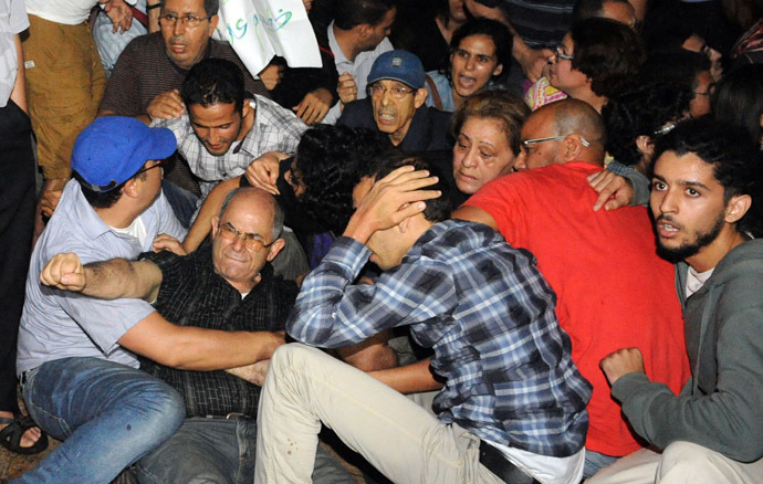 Angry protesters stage a demonstration on August 2, 2013 in Rabat-Morocco to protest the release of a Spanish paedophile, Daniel Fino Galvan who raped 11 local children was pardoned by the Moroccan King Mohammed VI. (AFP Photo/Fadel Senna)