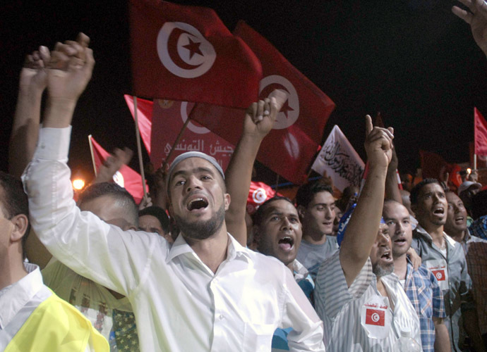 Tunisian supporters of ruling Islamist Ennahdha party chant slogans on August 3, 2013 in Tunis in solidarity with the government. (AFP Photo/Fethi Belaid)