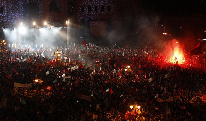 Supporters of the Islamist Ennahda movement attend a rally at Kasbah Square in Tunis August 3, 2013. (Reuters/Zoubeir Souissi)