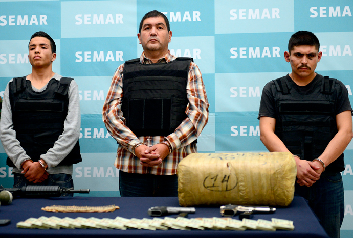 "Ivan Velazquez Caballero, aka ""Z 50"" or ""El Taliban"" (C), senior leader in the Zetas drug cartel and member of the Gulf cartel, is presented to the press at the Mexican Navy headquarters in Mexico City (AFP Photo / Alfredo Estrella)"