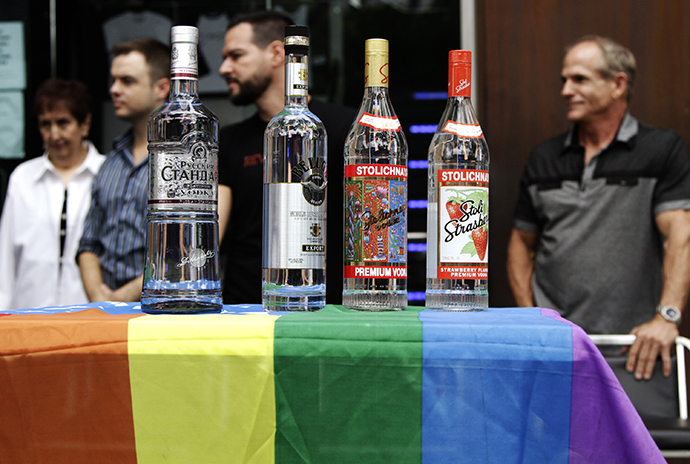 Bottles of Russian vodka are placed on an LGBT-themed American flag during a news conference in West Hollywood (Reuters / Jonathan Alcorn)
