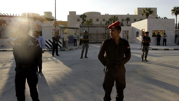 Jordanian policemen stand guard outside the US embassy in Amman on September 14, 2011 during a protest against the US policies in the Middle East (AFP Photo / Khalil Mazraawi)