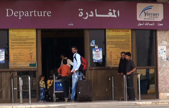 An image grab taken from an AFPTV video shows people entering the departure lounge at Sanaa International Airport as they prepare to leave Yemen on August 6, 2013 (AFP Photo / AFPTV)