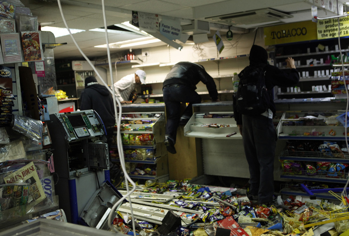 Looters rampage through a convenience store in Hackney, east London August 8, 2011 (Reuters)