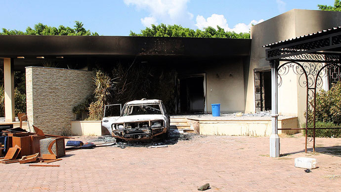 A burnt house and a car are seen inside the US Embassy compound on September 12, 2012 in Benghazi, Libya following an overnight attack on the building. The US ambassador to Libya and three of his colleagues were killed in an attack on the US consulate in the eastern Libyan city by Islamists outraged over an amateur American-made Internet video mocking Islam, less than six months after being appointed to his post.(AFP Photo / Stringer)