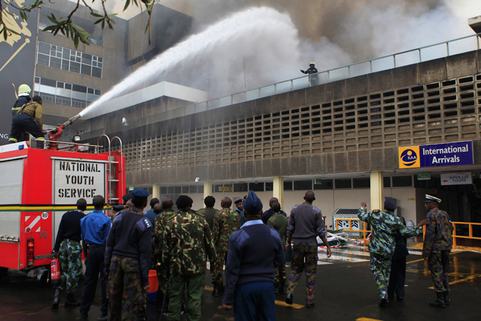 Fire fighters struggle to put out a fire at the Jomo Kenyatta International Airport in Kenya's capital Nairobi August 7, 2013 (Reuters / Noor Khamis)