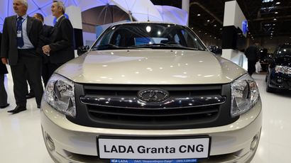 Visitors look at the Lada Granta CNG fueled by natural gas and petrol, presented at the 2013 AutoSib exhibition in Novosibirsk (RIA Novosti / Alexandr Kryazhev)