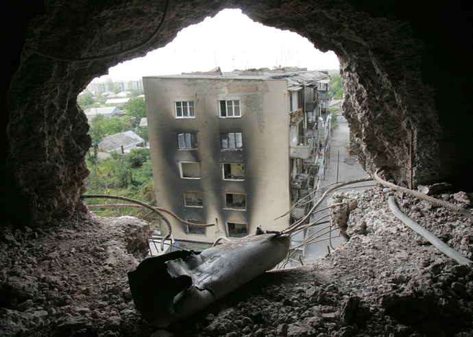 A shell casing lies inside a destroyed building in the South Ossetia town Tskhinval on August 27, 2008 (AFP Photo / Viktor Drachev)